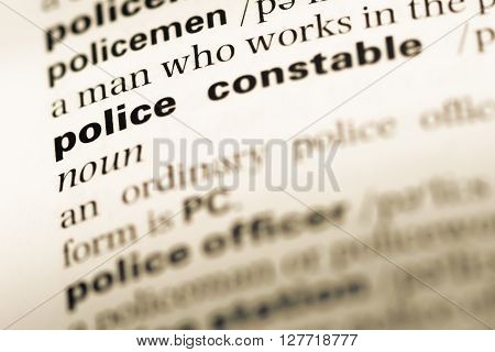 Close Up Of Old English Dictionary Page With Word Police Constable.