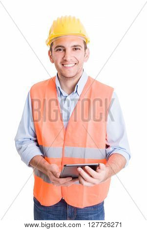 Modern and confident engineer holding tablet and smiling to the camera