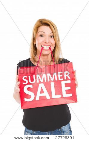 Shopping woman holding a gift bag with Summer sale text