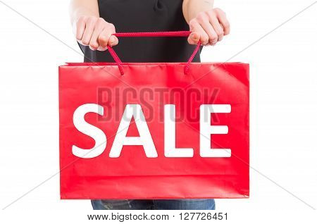 Shopping sale concept with a woman holding a red paper gift bag