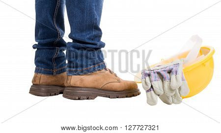 Contractor feet helmet and gloves isolated on white background