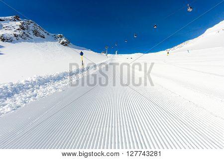 Beautifully groomed ski on the Tiefenbach glacier at the popular ski resort Soelden in Austria.