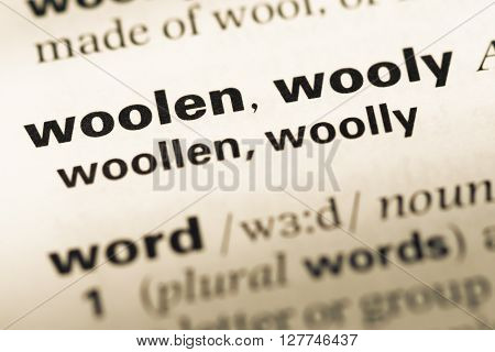Close Up Of Old English Dictionary Page With Word Woolen Wooly.
