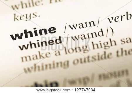 Close Up Of Old English Dictionary Page With Word Whine.
