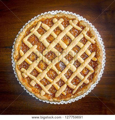 The image shows an home made jam tart