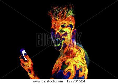 Fire, Body art glowing in ultraviolet light, isolated on black background