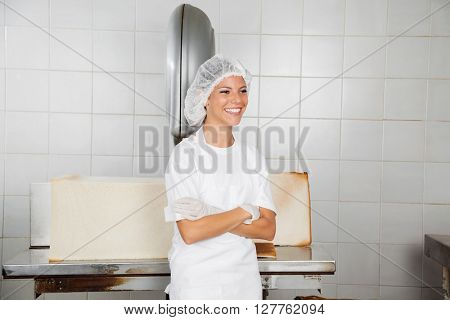 Female Baker Standing Arms Crossed While Looking Away