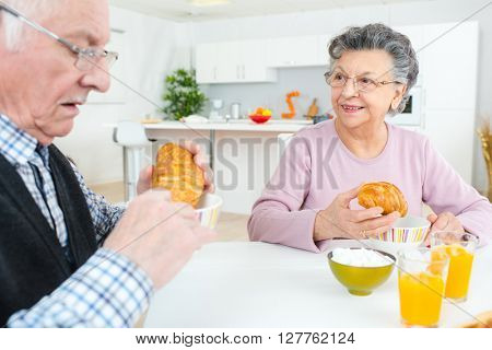 Elderly couple eating a Continental breakfast