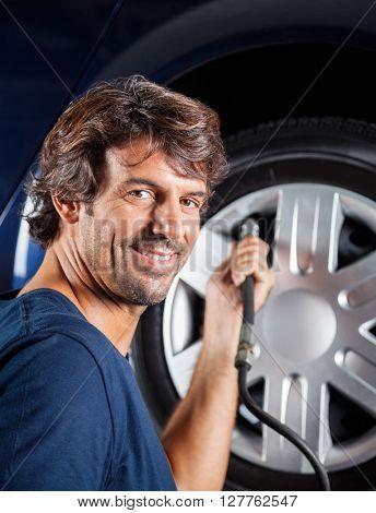 Mechanic Refilling Car Tire
