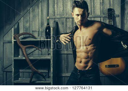 Muscular Man With Guitar