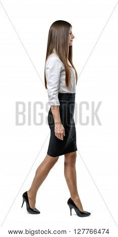 Cutout businesswoman in an office dress goes to side. Success and development. Business staff. Office clothes. Dress code. Presentable appearance. Beauty and youth. Walking pose.
