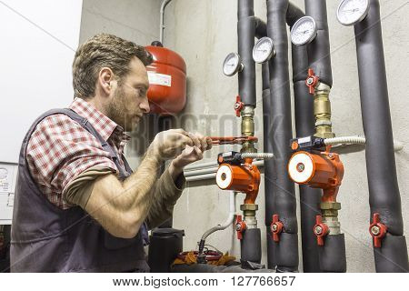 plumber at work installing a circulation pump