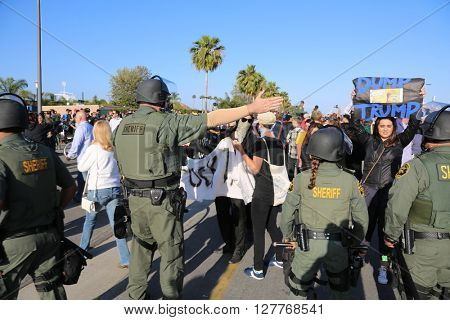 Costa Mesa, CA - April 28, 2016: Police in riot gear direct and control protesters of republican presidential candidate Donald Trump, at a rally at the Costa Mesa CA.