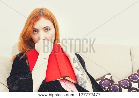 Young Woman With Red Cover Book