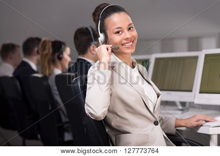 Young female telemarketer during her everyday job