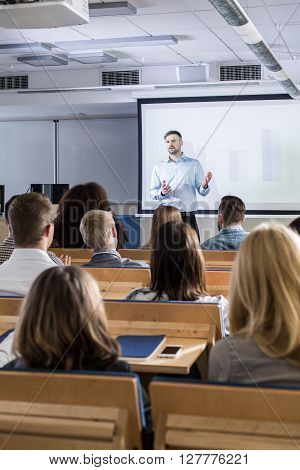 Shot of a teacher and his students during a lecture