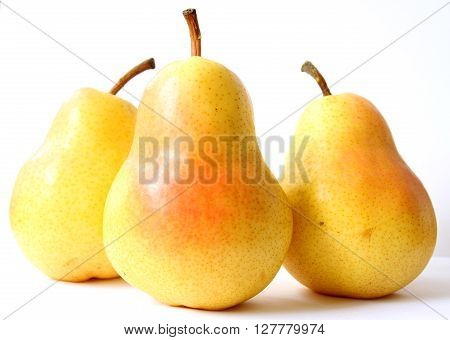 Group of three yellow pears, isolated on white background.