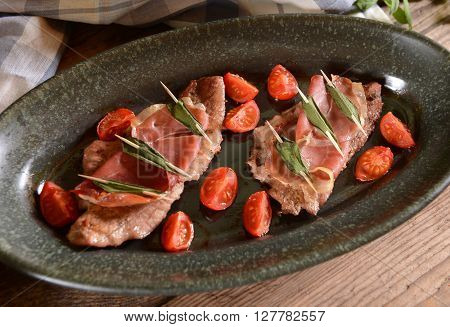 Saltimbocca meat with ham and sage leaves