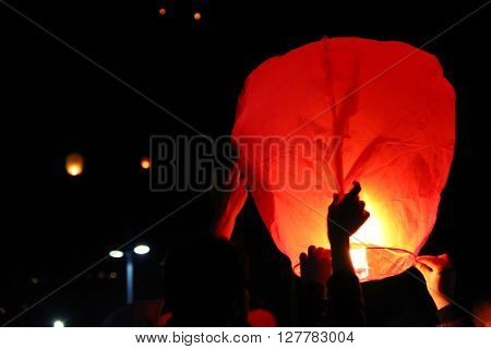 Making a wish with a floating lantern