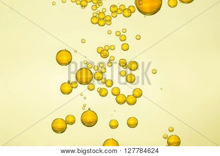 Beautiful golden champagne fizz bubbles over a light background