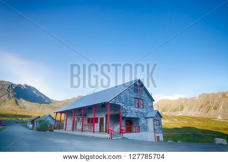 Single gold mining building in the middle of the Alaskan wilderness.