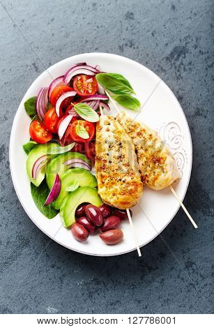 Grilled Sesame Chicken Skewers with Fresh Vegetables and Kalamata Olives