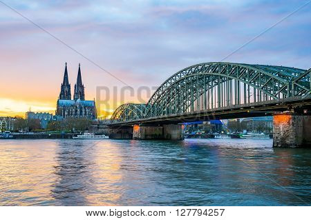 Sunset At The Cologne Cathedral With Hohenzollern Bridge In Cologne, Germany