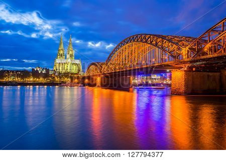 Night At The Cologne Cathedral With Hohenzollern Bridge In Cologne, Germany
