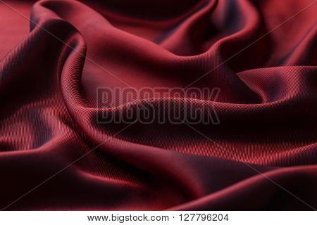 Red texture wavy glossy silk drapery, background