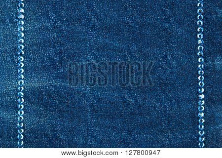 Luxury fashion background inlaid with blue rhinestones top view