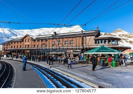 Kleine Scheidegg Switzerland - December 28 2015 - Tourists waiting for the train to Jungfraujoch at the Kleine Scheidegg Station Switzerland.