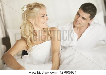 Lovely Married Couple Teasing Each Other Lying On Bed.