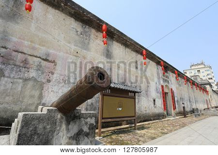 SHENZHEN, CHINA - MARCH 28, 2016: Historic cannon at Crane Lake Walled Village on March 28, 2016 in Shenzhen, China. It is a landmark Hakka village of national significance in Guangdong province.