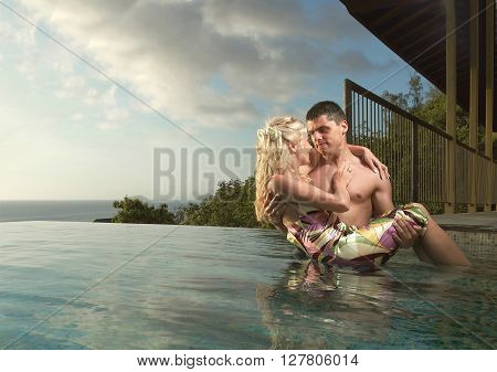 Young, Sexy And Attractive Couple Coming Into Swimming Pool In Sexual Embrace.