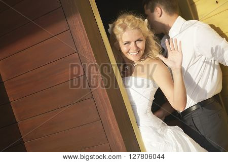 Lovely Bride Saying Good Bye Near Door After Wedding.