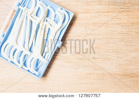 Oral Device : White Dental Flossers On Wooden Background