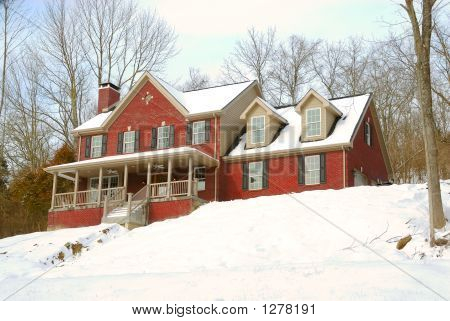 Brick House On A Snowy Hillside