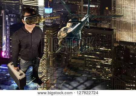 A person wears virtual reality glasses and holds a metal suitcase in his hand. He stands in a virtual reality environment of New York at night. A helicopter flies through the scene.