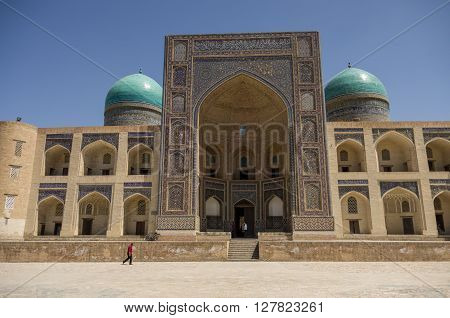 Decorated With Traditional Ornament Facade Of Mir-i Arab Madrasah, Historic Centre Of Bukhara, Uzbek