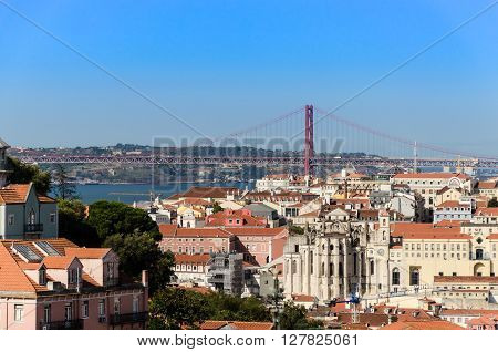 cityscape of lisbon with the view of barrio and chiado quarter and the 25th april bridge