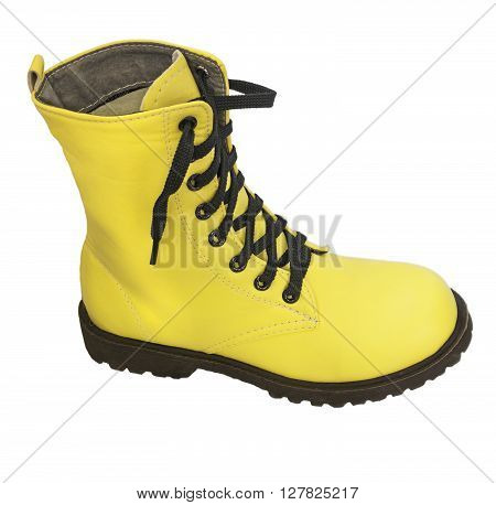 One high yellow boots with black laces on a white background