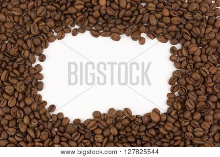 frame images laid out from coffee beans on a white background