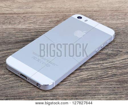 Minsk, Belarus - April 16, 2016: Apple iPhone 5, 5S. White version. Back view. The operating system iOS 9. The founders of the company: Steve Jobs, Ronald Wayne, Steve Wozniak. Apple Inc. Located in USA.