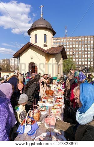 Moscow, Russia - April 30, 2016: Consecration of Easter cakes and eggs for Easter near the chapel in honor of Our Lady The Inexhaustible Chalice in the church of Our Lady of Sorrows Three Hands on Kashira Highway. Moscow