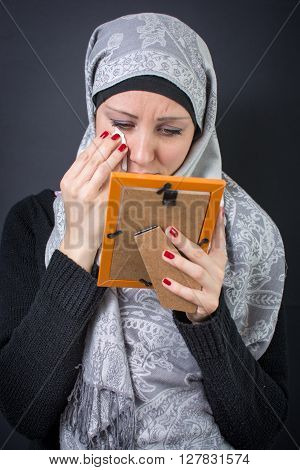 Muslim Woman Moaning Over A Photograph