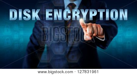 Corporate network administrator is touching DISK ENCRYPTION on a virtual screen. Information technology concept for data conversion into unreadable code to be deciphered by authorized users only.
