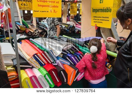 Family Buying Textile Items