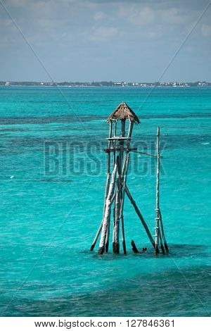 Wooden fishing tower hut / cabin on the Mexican island called Isla Mujeres (Island of the Women) on Acantilado del Amanecer (Cliff of the Dawn)