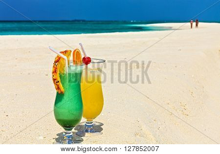 Two glasses of cocktail are on beach Maldives The Indian Ocean