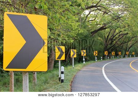 The road curve with street signs reflex lightAt night you can see the signs more clearly.